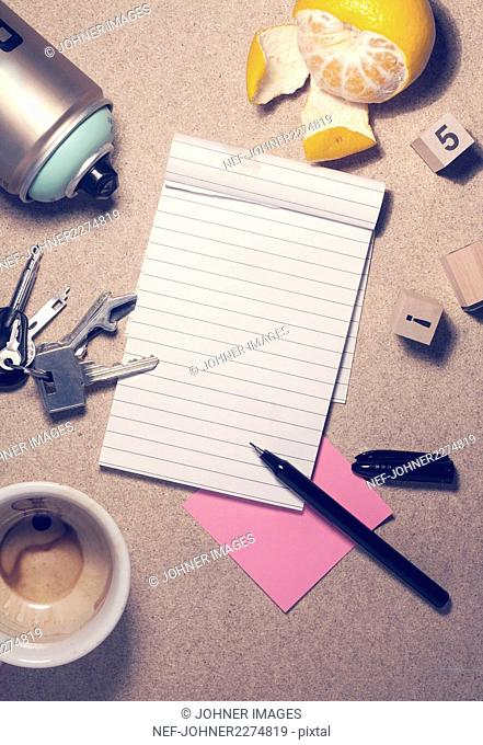 Open notepad and various items on desk