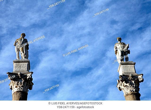 Roman columns topped with statues of Hercules and Julius Caesar at the Alameda de Hercules, Seville, Spain