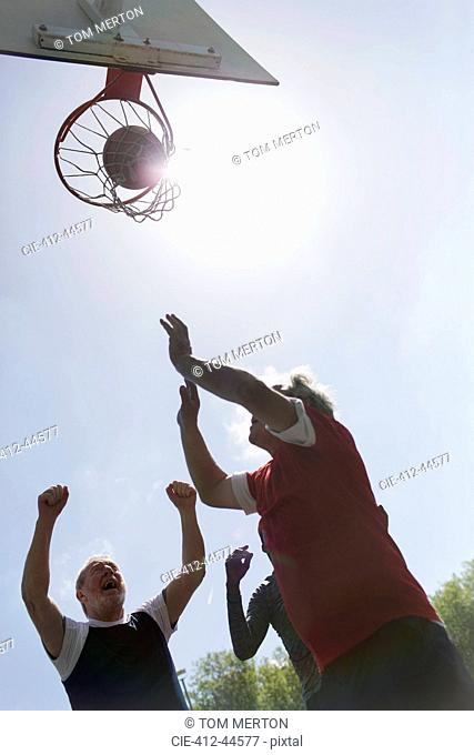 Active senior men playing basketball
