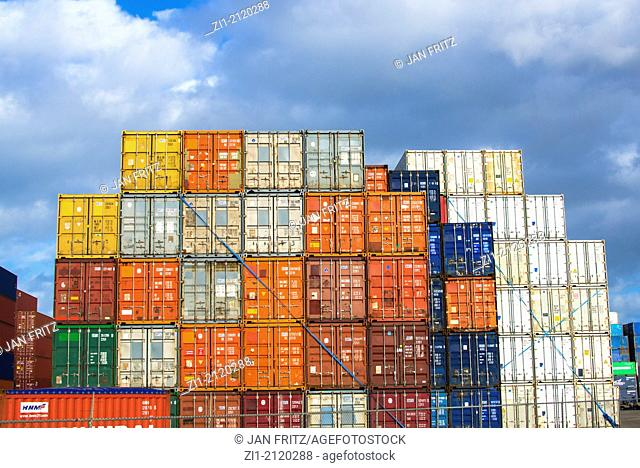 stacked containers in Rotterdam harbour, the Netherlands