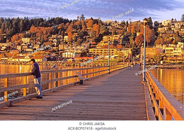 Sunset light on White Rock pier, 500 metres long, built in 1913 as a steamship landing dock, White Rock, British Columbia, Canada