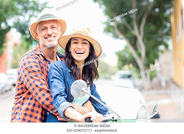 Portrait of couple on moped
