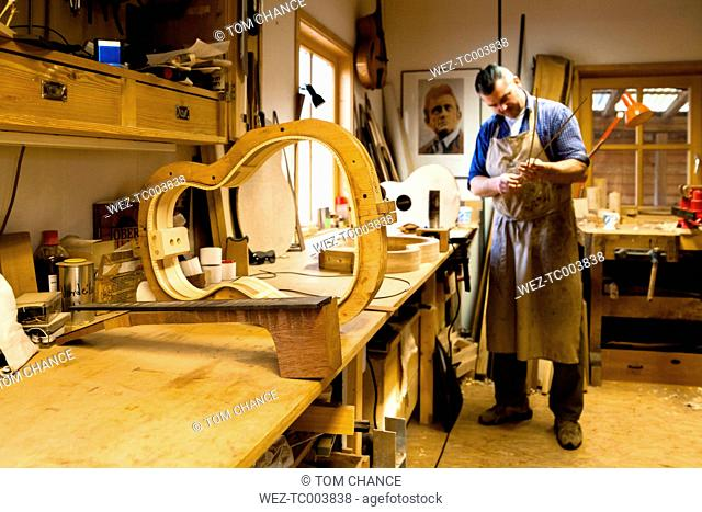 Guitar maker in his workshop
