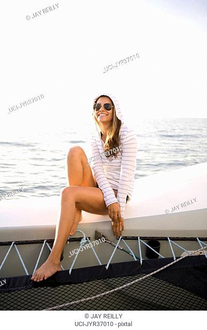 Woman sitting on sailboat