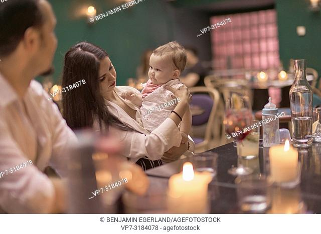 couple with baby at table in restaurant, Vegan Oriental, Kismet, in Munich, Germany