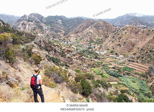 Hiker enjoying the view, Vallehermoso, La Gomera, Canary Islands, Spain