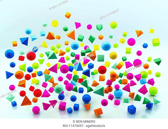 Abstract floating multicolored geometric shapes on blue background