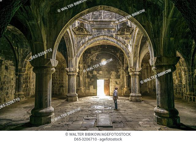 Armenia, Debed Canyon, Haghpat, Haghpat Monastery, 10th century, Church of the Holy Cross, interior with visitor, MR