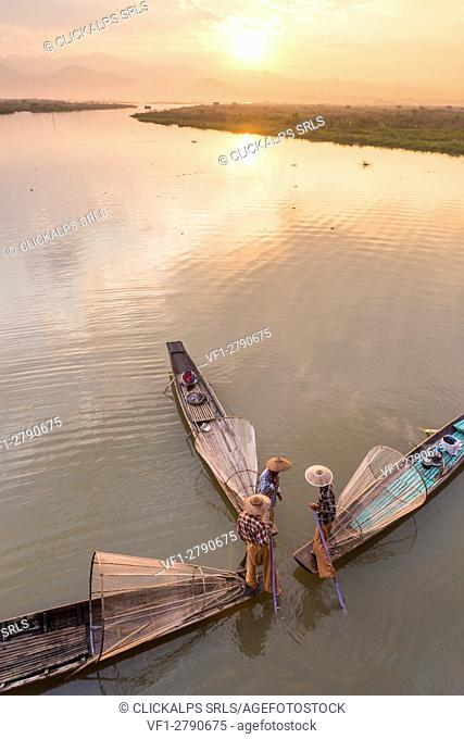 Inle lake, Nyaungshwe township, Taunggyi district, Myanmar (Burma). Thee local fishermen with the conic nets on the boats seen from above