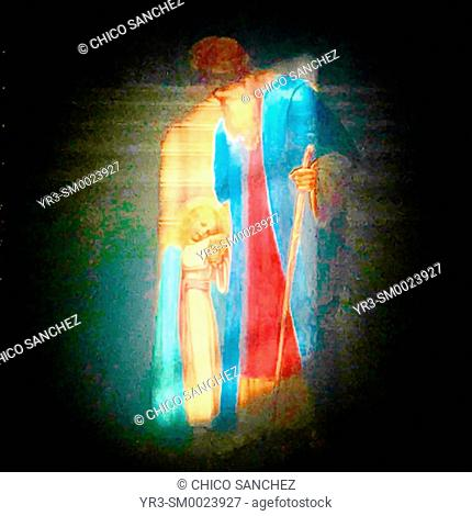 An image a young Virgin Mary carried by her father Saint Joachim, illuminated in the Cathedral of Our Lady of the Assumption in Oaxaca, Mexico