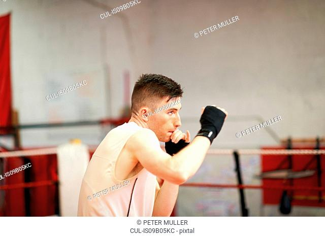 Boxer practising in boxing ring