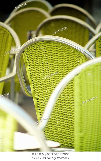 Green/yellow chairs in the street