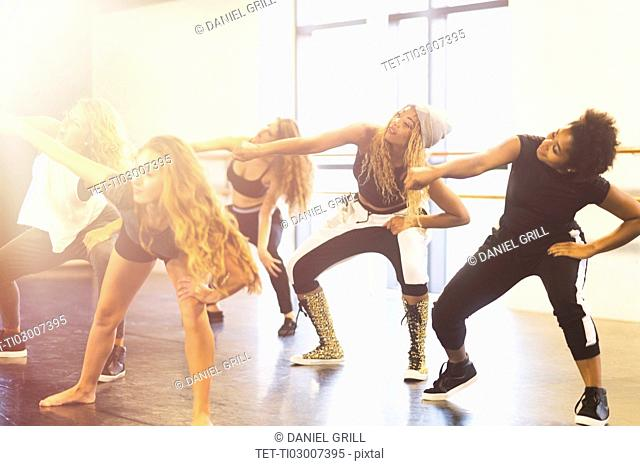 Young women dancing in dance studio