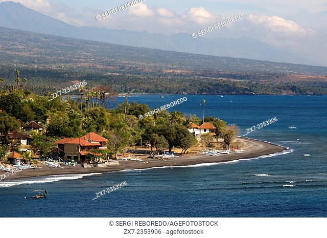 The small village of Amed fisherman with views of Mount Gunung Agung background (3142m). East Bali. Amed is a long coastal strip of fishing villages in East...