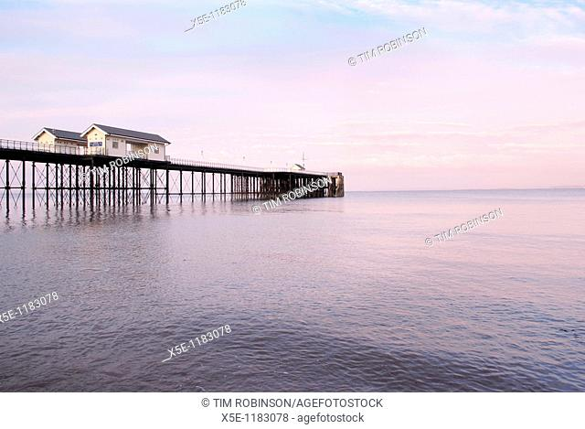 Pier at Penarth, Wales, at sunset with calm sea