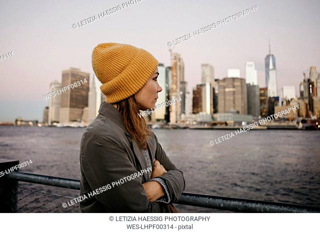 USA, New York, New York City, Female tourist at East River