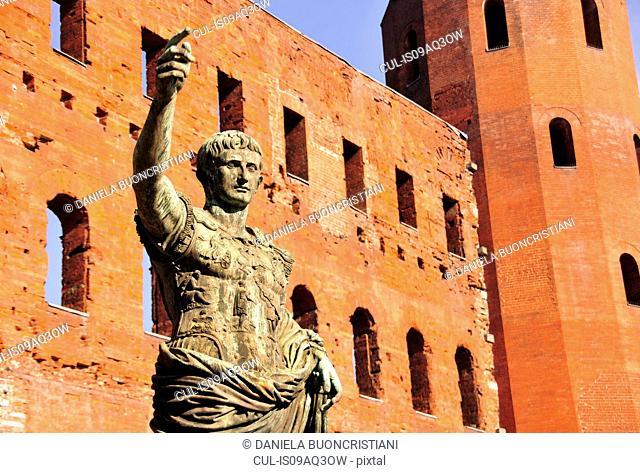 Ancient Roman bronze statue of Emperor Caesar, Porte Palatine city gate, Turin, Piedmont, Italy
