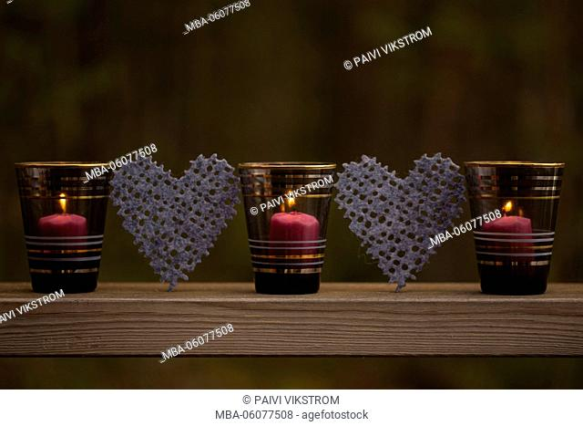 Three candles with two hearts, outdoor decor