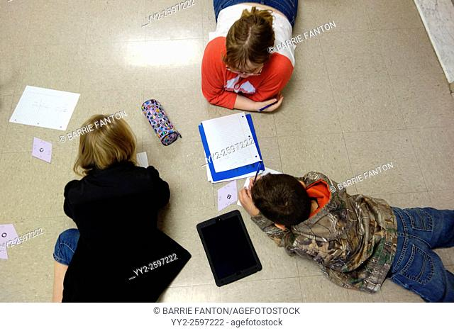 6th Grade Boy and Girls Solving Math Problem, Wellsville, New York, United States
