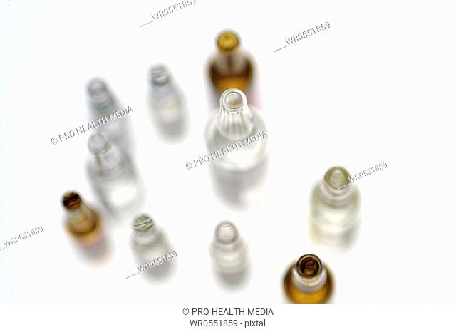 several ampoules with medicine on white