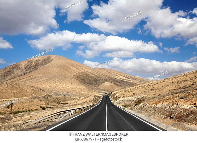 Road through a barren mountain landscape, Fuerteventura, Canary Islands, Spain