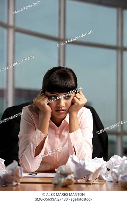 Indian woman stressed at work