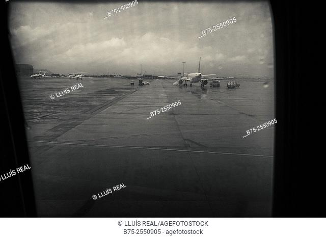 View from the window of a plane at Barcelona airport with several aircraft. Barcelona, Spain, Europe