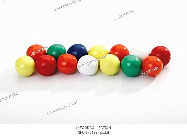 Coloured bubble gum balls in a row