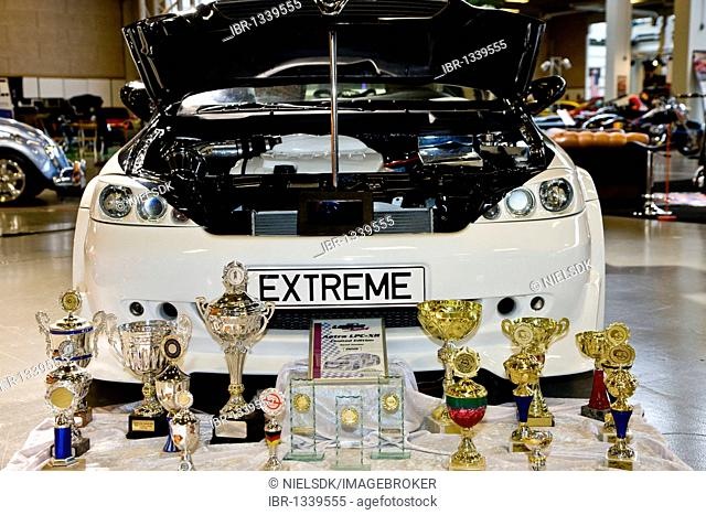 Winner cups in front of the extreme Opel car at Scandinavian Custom Show in Bella Center, Copenhagen, Denmark, Europe
