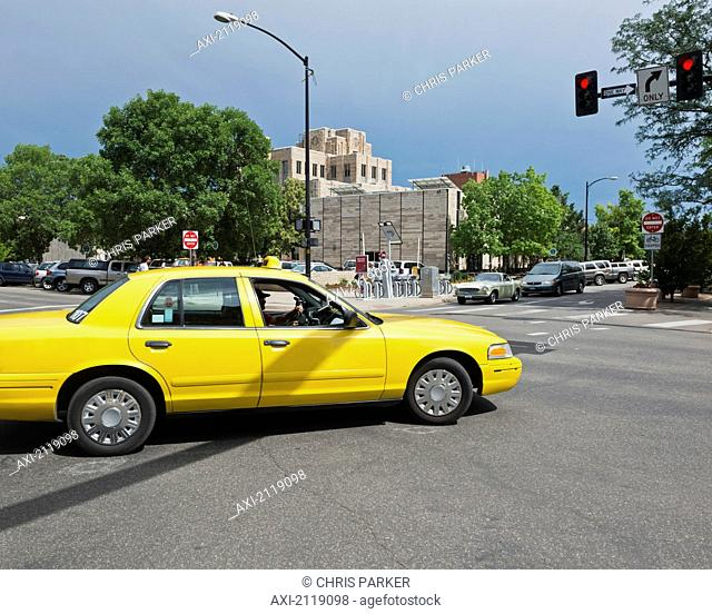 Usa, Colorado, Yellow Cab In Front Of Art Deco Style Courthouse Downtown Boulder; Boulder
