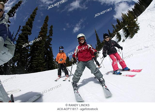 Family skiing together, Whistler Mountain, British Columbia, Canada