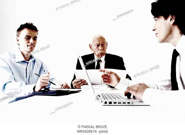 Three businessmen in a meeting
