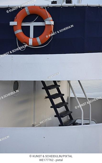 Life ring on a metal ship