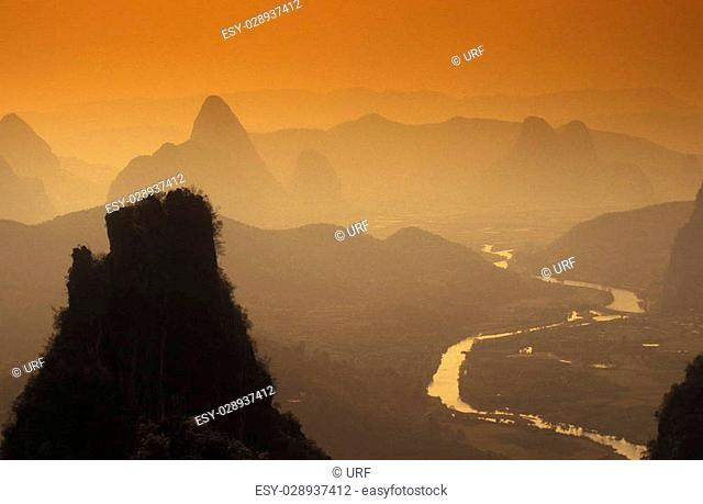 the landscape at the Li River near Yangshou near the city of Guilin in the Province of Guangxi in china in east asia