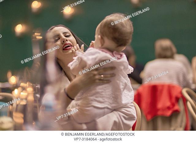 mother with baby in restaurant, Vegan Oriental, Kismet, in Munich, Germany