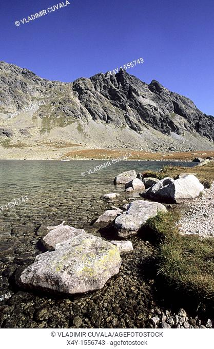 Granite boulders on the shore of the largest tarn in High Tatras Slovakia - Velke Hincove pleso