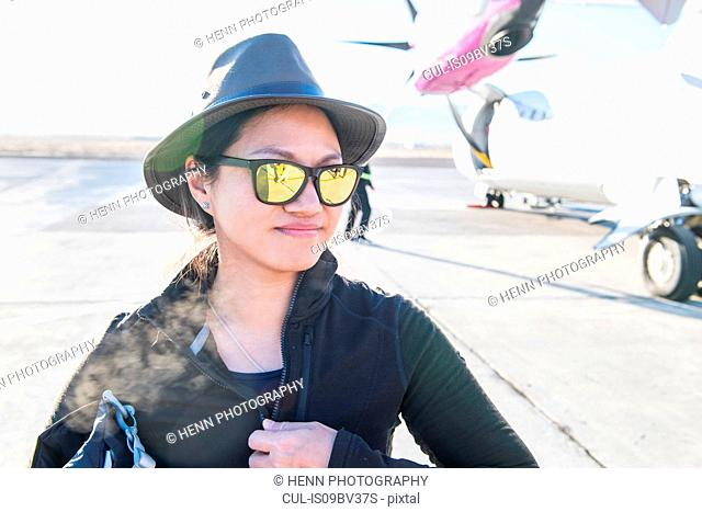 Tourist getting on domestic flight, Ulaanbaatar, Mongolia