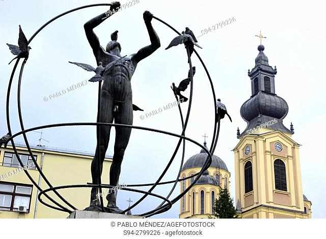 Sculpture and Saborna Rodenja church in Sarajevo, Bosnia and Herzegovina