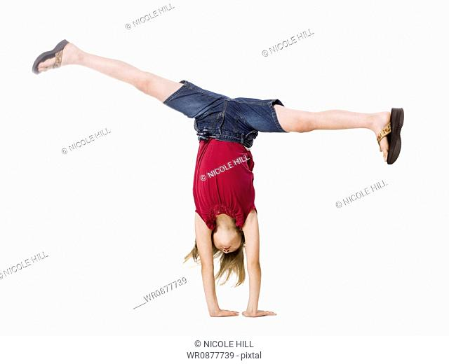 girl doing a hand stand