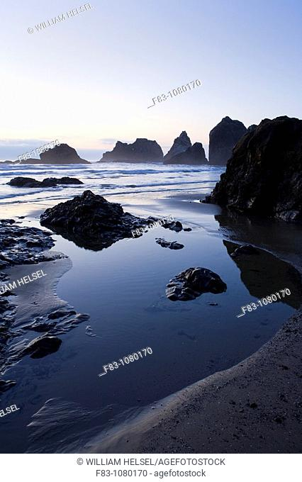 USA, Oregon, Tillamook County, Oceanside, sea stacks, rocky shoreline, beach and tidepool, sunset, low tide, August