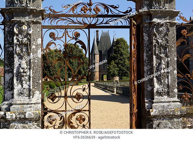 France, Normandy, Orne, Carrouges, Chateau de Carrouges historic wrought iron gates with the gatehouse beyond
