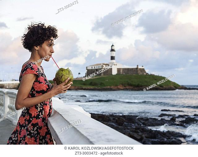 Brazilian Model drinking Coconut Water, Barra Neighbourhood, Salvador, State of Bahia, Brazil
