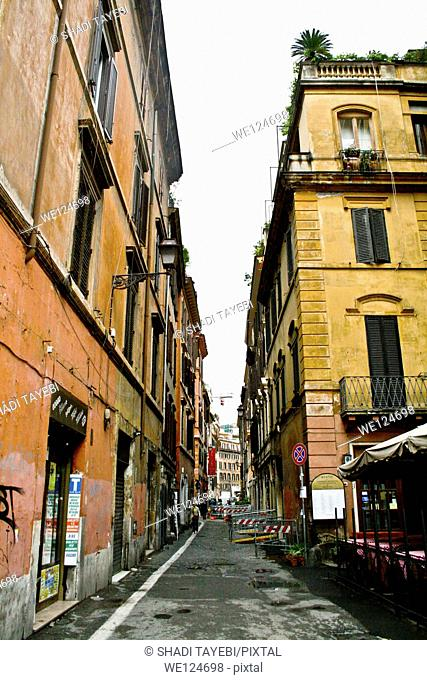 Old buildings in the old area of the town in a narrow street in Madrid, Spain