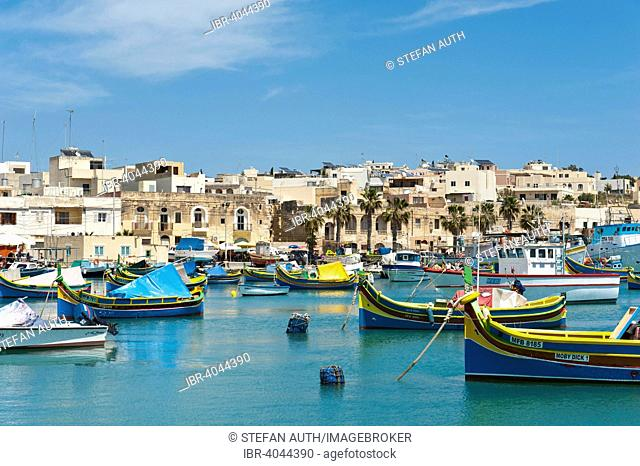 Colorfully painted traditional fishing boats, Luzzu, harbour of Marsaxlokk, Malta