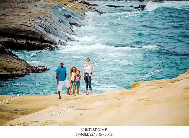 Family smiling on beach