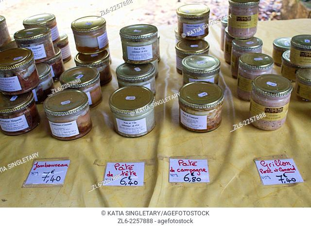 Jars of foie gras, the french liver pate, for sale outside market of Souillac, in the Dordogne Valley in France. Dordogne is well known for nuts, and foie gras