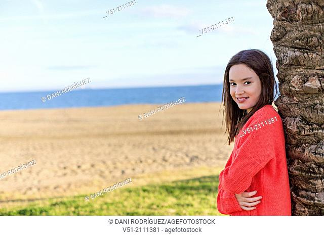 Portrait of a young girl smiling at camera at the beach