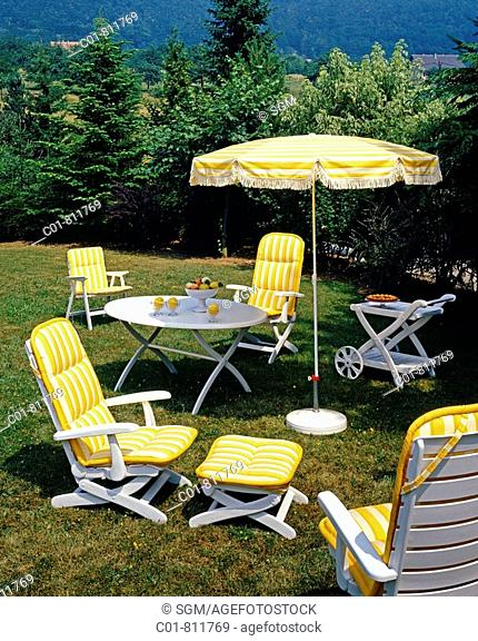Garden furniture chair, armchairs and parasol decorated with yellow stripe