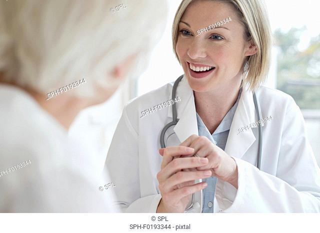 Female doctor smiling towards patient