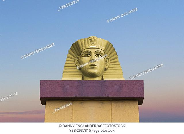 Surreal image of an Egyptian Pharaoh monument with a dreamy blue sky in the background